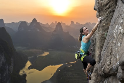 Female climber against sunset at Li River