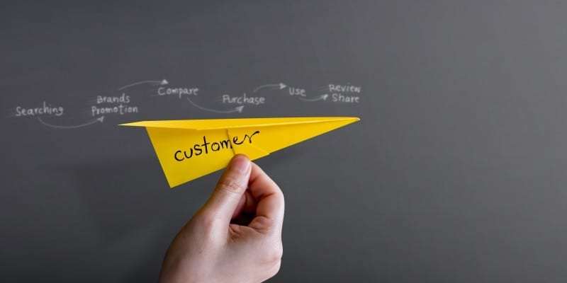 Customer Journey and Experience. Hand Raise Up a Paper Plane