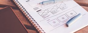 A notebook containing drawings of web design plans, representing ways web design affects SEO.