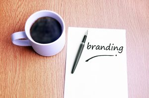 Coffee, pen and notes write branding
