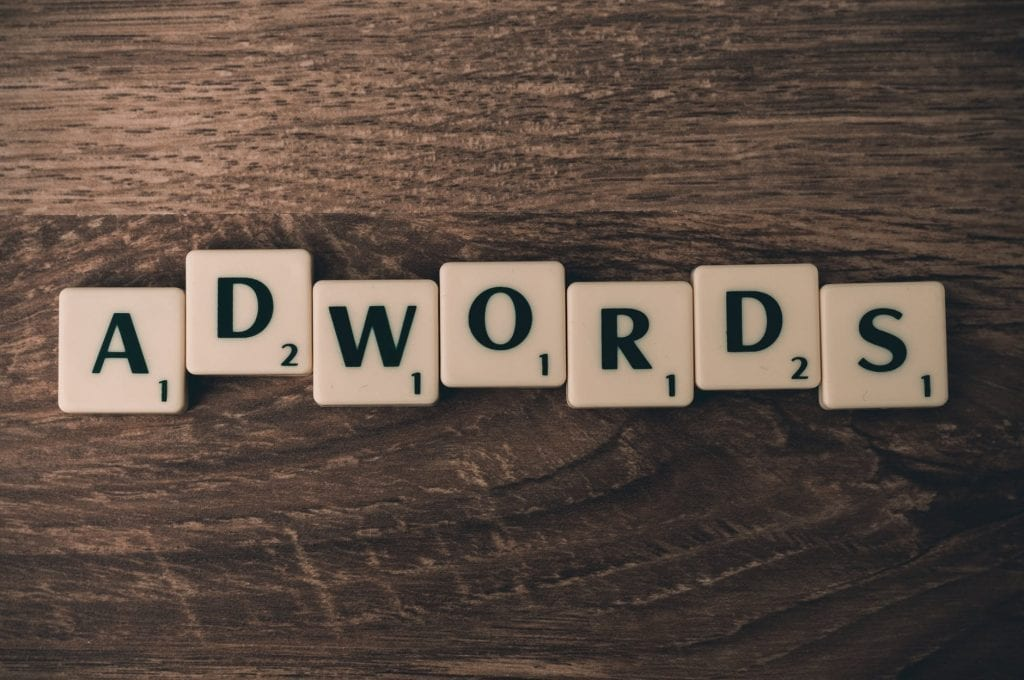 Adwords, now Google Ads, written in Scrabble letters