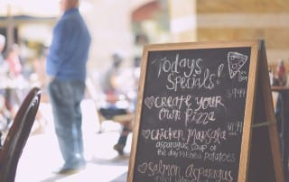 True product placement: a handwritten sign outside of italian marketing