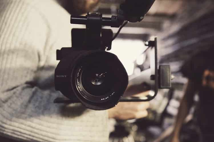 A person looking through a video camera