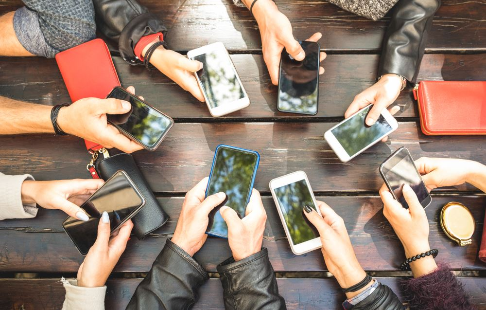 different people with different phones for personalized content