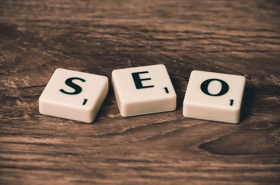small white cubes with black letters that spell our SEO.