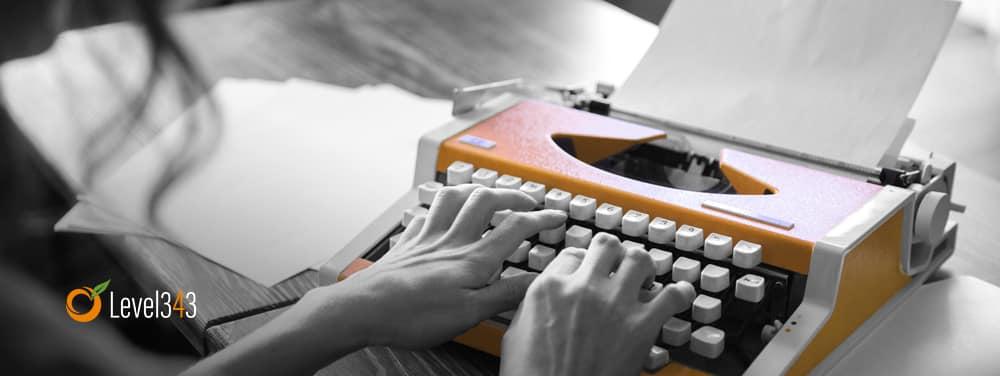 authoress writing headlines on a typewriter